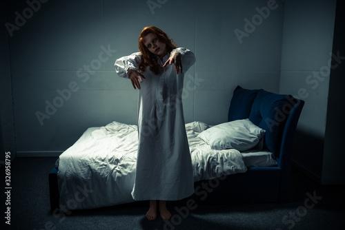 Canvastavla creepy female demon in nightgown standing in bedroom