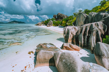 La Digue Island, Seychelles. Beautiful Holiday Vacation View At Paradise Anse Source D'Argent Beach With Shallow Blue Lagoon, Granite Boulders And Clouds