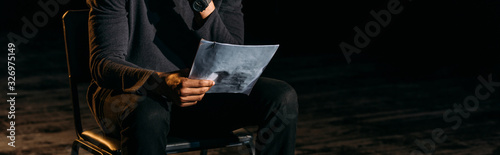 Fototapeta panoramic shot of african american actor holding scenario on stage during rehear