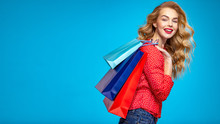 Happy Young Woman Holds Bags W...