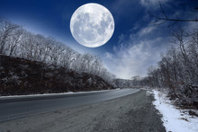 Winter Road And Fantastic Huge Moon