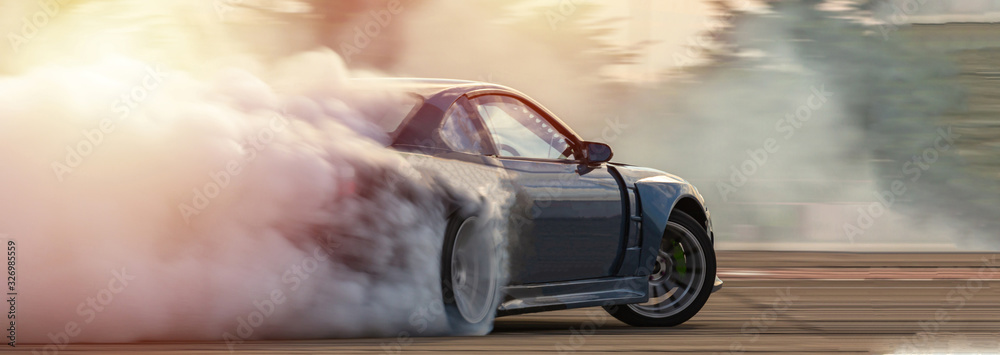 Fototapeta Car drifting, Blurred  image diffusion race drift car with lots of smoke from burning tires on speed track.