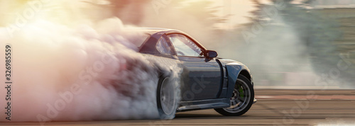 Fotografía Car drifting, Blurred  image diffusion race drift car with lots of smoke from burning tires on speed track