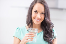 Young Woman Drinks Clean Water...