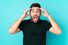 Caucasian Handsome Man Isolated On Blue Background With Surprise Expression