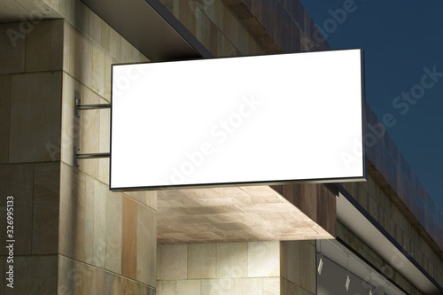 Fototapeta Horizontal singboard or signage on the marble wall with blank luminescent sign mock up. Night scene. Bottom view. 3d illustration obraz