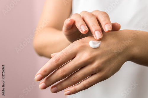 closeup of tender hands of a young woman with moisturizer on Wallpaper Mural
