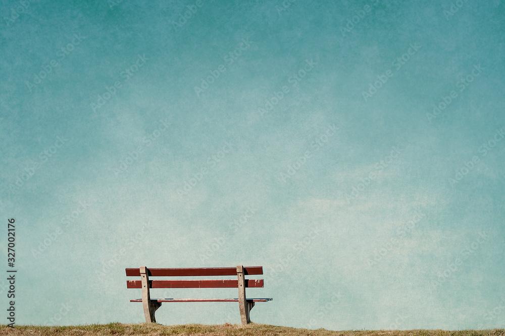 Fototapeta empty bench in an empty blue background