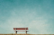 canvas print picture - empty bench in an empty blue background