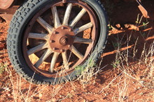 Wooden Spoke Wheel Of Rusting Model T Ford In The South Ausralian Outback