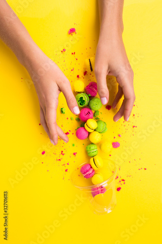 Colored, bright, sweet macaroons on a yellow background Canvas Print