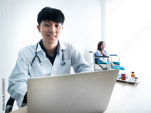 Asian specialist doctor man wear gown appoint check up disability patient woman Wallpaper Mural