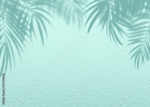 Mint Blue cement texture wall leaf plant shadow background.Summer tropical travel beach with minimal concept. Flat lay pastel color palm nature .