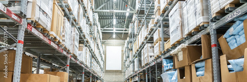 Fototapeta Panorama of Rows of shelves with boxes in modern warehouse obraz