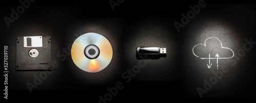 Fotografia Composition on a black background from a floppy disk, a laser disk, a USB flash drive and a cloud storage symbol