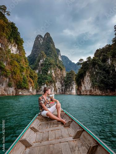 Fototapeta Khao Sok National park Thailand, couple on vacation at Khao Sok park Thailand, men in longtail boat obraz na płótnie
