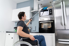 Disabled Man Using Grabber Too...