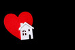 Wooden house with a red heart on a black background