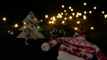 LED Christmas Tree With Woolen Reindeer Sweater In Foreground