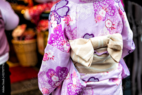 Kyoto, Japan closeup of unrecognizable woman in purple kimono with cherry blosso Wallpaper Mural