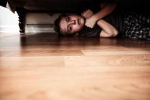 Scared Boy Hiding Under The Bed