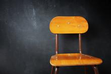 Empty Wooden School Chair Agai...