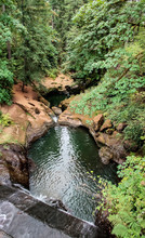 Tranquil Potters Falls And Dam At Lacamas Park In The Summertime Cascading Into An Emerald Pool In Camas Washington