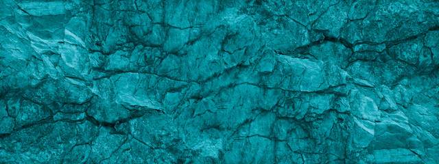 Blue green stone background. Underwater rocky texture. Close-up. Toned mountain texture.
