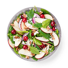 Homemade Salad With Fresh Baby Spinach, Red Apple, Cranberry, Walnuts And Feta Cheese. Isolated On White Background