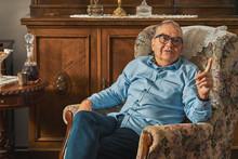 Senior Jew Sitting In Armchair...
