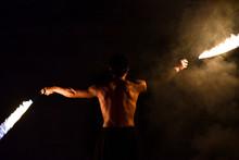 Fakir Juggles Fire On A Black ...