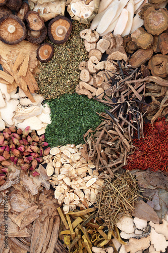 Chinese herbs used in traditional ancient herbal medicine forming a background.  Wall mural