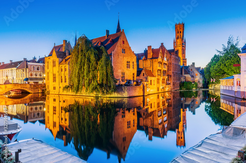 Bruges, Belgium. The Rozenhoedkaai canal and the Belfry. Canvas Print