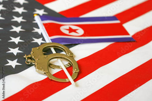 North Korea flag in handcuffs on the background of the American flag Wallpaper Mural