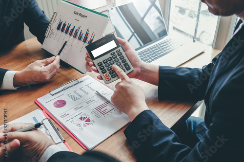 Group of business people meeting together to assess business profits Wallpaper Mural