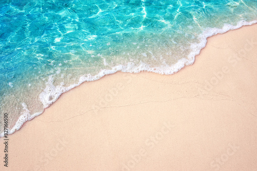 Beautiful Soft blue ocean wave on fine sandy beach - 327166500