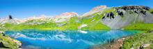 Panoramic View Of Turquoise Vibrant Ice Lake Near Silverton, Colorado On Summit Rocky Mountain Peak And Snow In August 2019 Summer Panorama