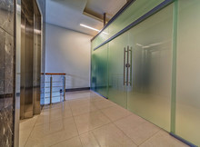 Modern Frosted Glass Doors Entrance Near Elevator