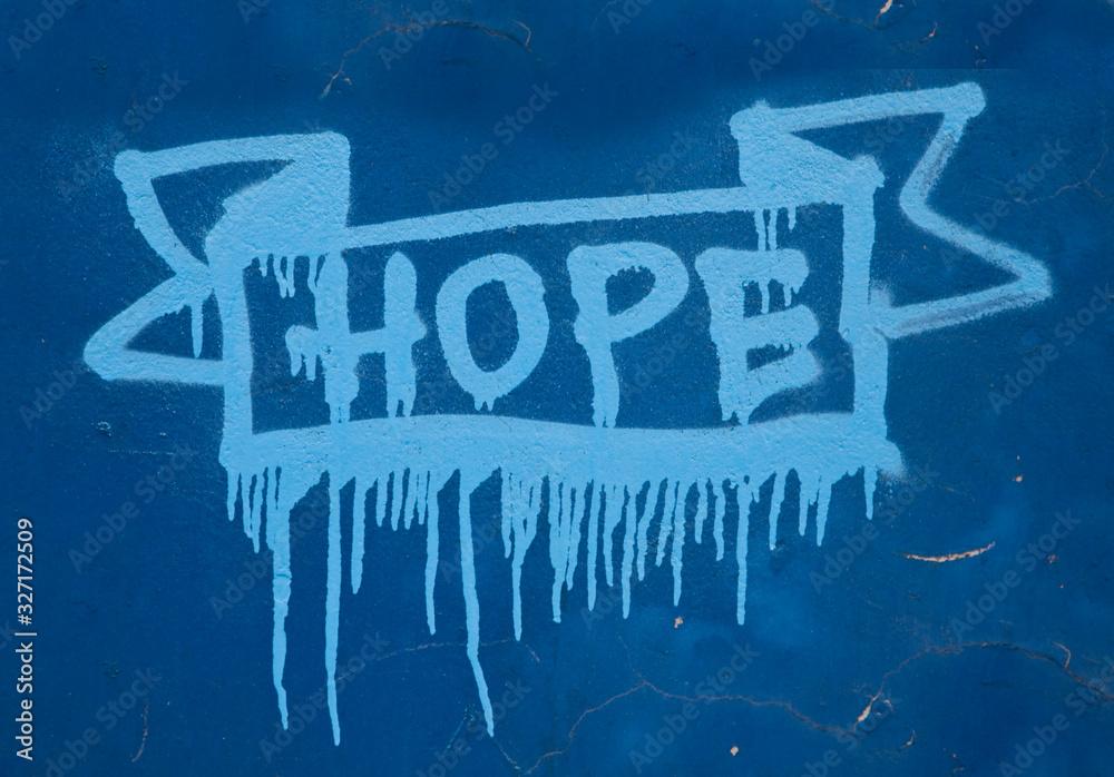 Fototapeta Grafitti street art słowo hope namalowane sprayem na niebieskiej ścianie