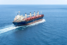 A Old Bulk Carrier Or Bulker Sails In The Sea To Trade Around The World