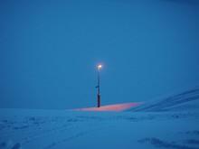 Streetlamp In A Snowy Landscap...