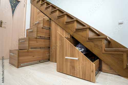 Modern architecture interior with luxury hallway with glossy wooden stairs in multi-storey house Fototapeta