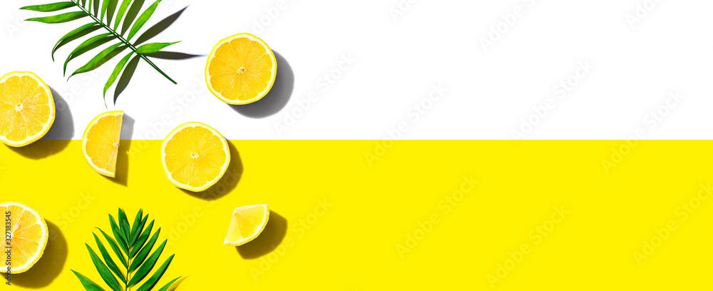 Fototapeta Fresh yellow lemons overhead view - flat lay