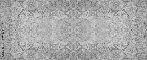 Old gray vintage shabby patchwork tiles stone concrete cement wall texture ba...