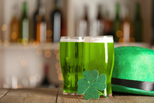 Green Beer, Clover And Hat On Wooden Counter, Space For Text . St.Patrick's Day Celebration