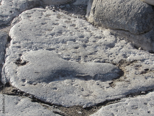 Fényképezés Phallic shaped carving on the road in Pompeii, Italy pointing the way to the bro