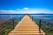 Hard modern wooden bridge at popular tourist port
