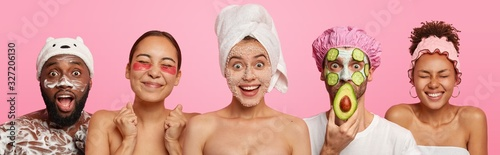 Obraz Collage of five different people have hygienic, beauty treatments, apply face masks, patches and wash body with shower gel, stand next to each other, isolated over pink background, visit cosmetologist - fototapety do salonu