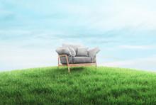 Empty Armchair In A Grass Field, 3d Rendering