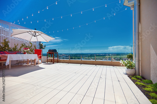 Obraz furnished patio zone, rooftop terrace at warm summer day - fototapety do salonu